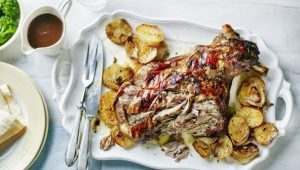 Slow roast shoulder of lamb with sliced potatoes