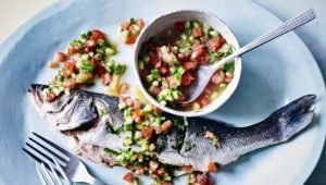 Whole sea bass with warmed tomato and citrus salsa