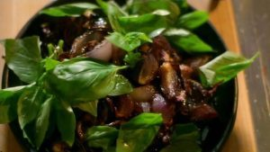 Roasted red onions with basil