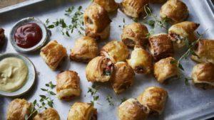 Mini sausage rolls and veggie red pepper ricotta puffs