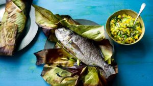 Whole fish cooked in a banana leaf with mango chutney