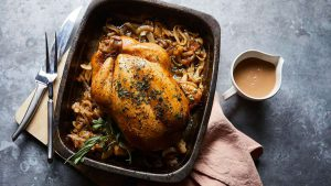Roast chicken with tarragon butter and melting onions
