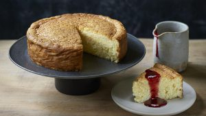 Rice pudding cake with raspberry jam sauce